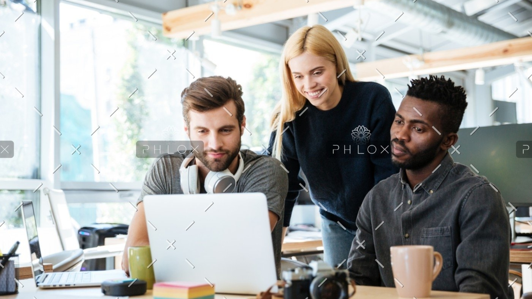 demo-attachment-447-happy-colleagues-sitting-in-office-coworking-PHYA6TG